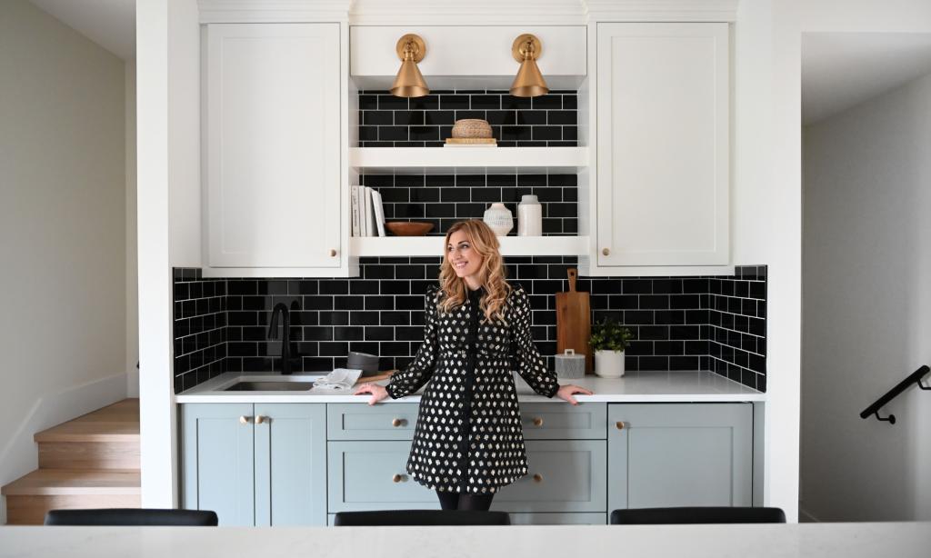 maria decotiis vancouver ca invest in interior designer designer standing in kitchen with black subway backsplash